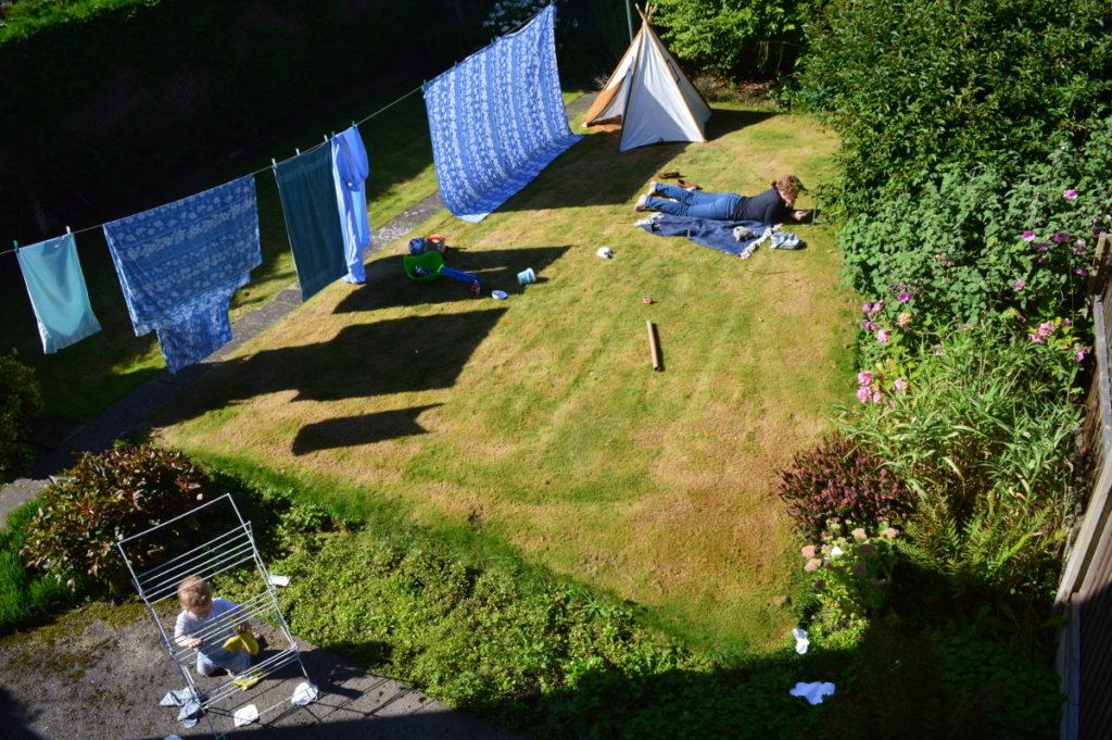 Enjoying the sun in the back garden.